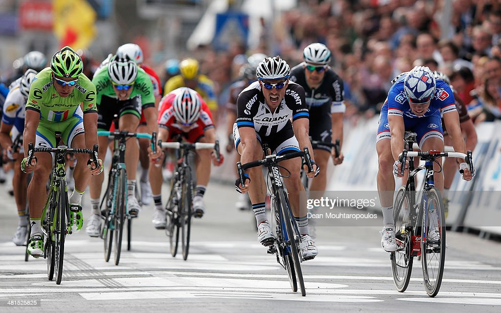 <a gi-track='captionPersonalityLinkClicked' href=/galleries/search?phrase=John+Degenkolb&family=editorial&specificpeople=5542317 ng-click='$event.stopPropagation()'>John Degenkolb</a> (C) (Giant-Shimano) of Germany sprints to victory ahead of Arnaud Demare (FDJ.fr) of France and <a gi-track='captionPersonalityLinkClicked' href=/galleries/search?phrase=Peter+Sagan&family=editorial&specificpeople=4846179 ng-click='$event.stopPropagation()'>Peter Sagan</a> (Cannondale) of Slovakia during the Gent-Wevelgem Cycle Race on March 30, 2014 in Gent, Belgium.
