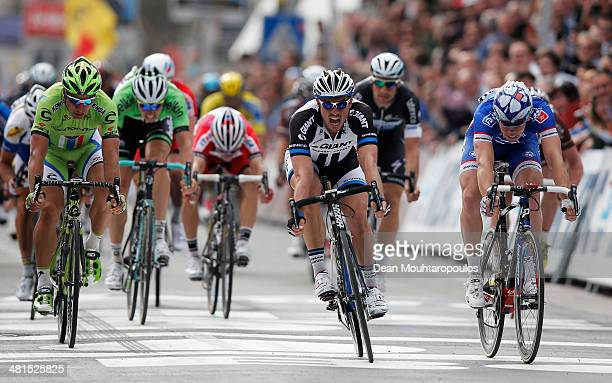 John Degenkolb of Germany sprints to victory ahead of Arnaud Demare of France and Peter Sagan of Slovakia during the GentWevelgem Cycle Race on March...