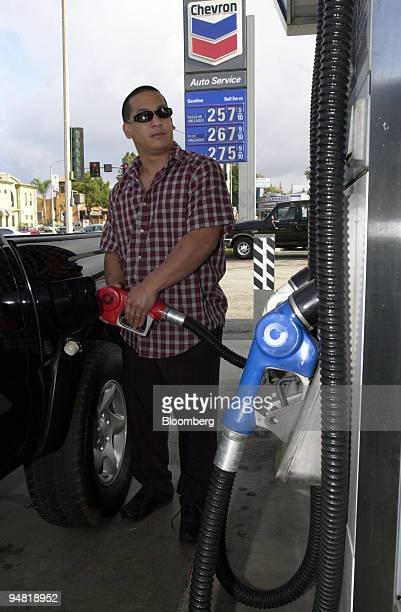 John DeLeon pumps gas at a Chevron gas station in Pasadena California Monday April 4 2005