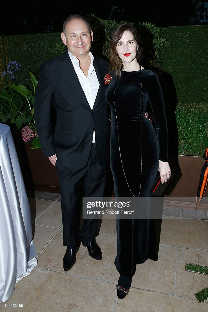 John Dempsey (L) and guest attend the Amfar Paris Dinner - Stars gather for Amfar during the Haute Couture Week - Held at The Peninsula Hotel on July 3, 2016 in Paris, France.