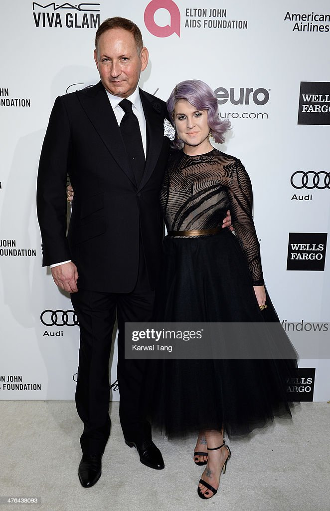 John Dempsey and Kelly Osbourne arrive for the 22nd Annual Elton John AIDS Foundation's Oscar Viewing Party held at West Hollywood Park on March 2, 2014 in West Hollywood, California.