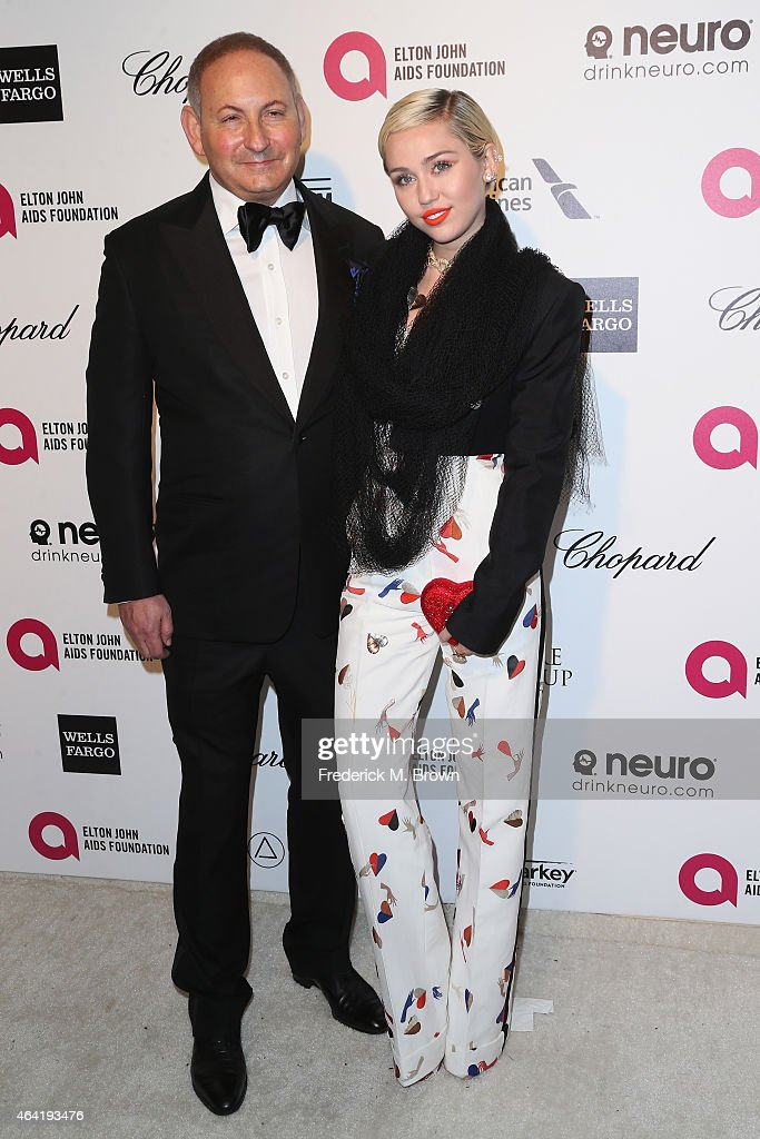 John Dempsey and singersongwriter Miley Cyrus attend the 23rd Annual Elton John AIDS Foundation's Oscar Viewing Party on February 22 2015 in West...