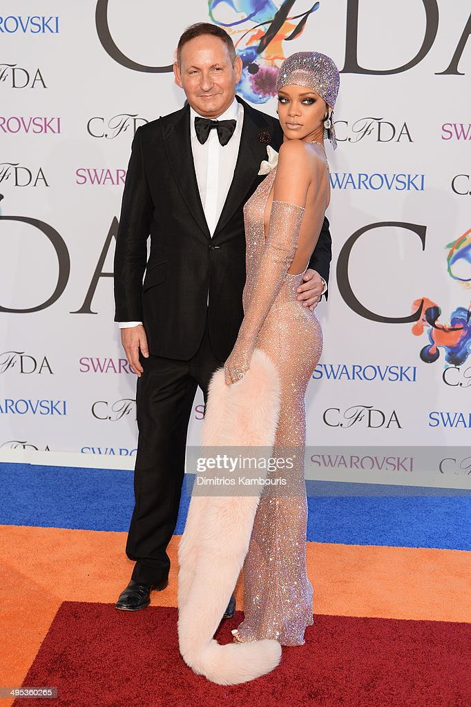 John Dempsey President of MAC Cosmetics and Rihanna attend the 2014 CFDA fashion awards at Alice Tully Hall Lincoln Center on June 2 2014 in New York...