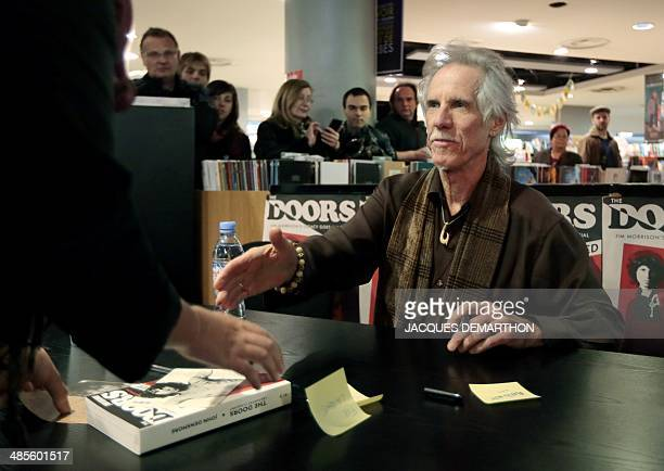 John Densmore US musician and drummer of the rock group The Doors shakes hand with a visitor during a signing session of his book 'The Doors...