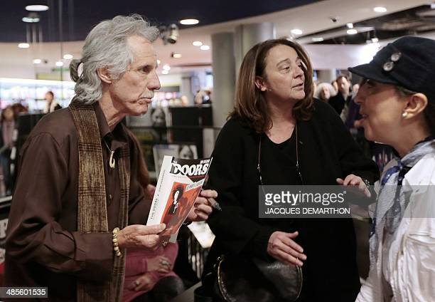 John Densmore US musician and drummer of the rock group The Doors speaks with visitors during a signing session of his book 'The Doors Unhinged' in a...