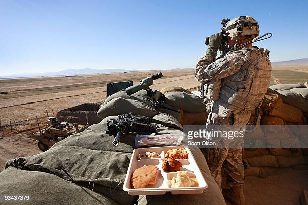 John Dever of Chicago IL with Blackfoot Company 1st Battalion 501st Parachute Infantry Regiment has Thanksgiving dinner while standing watch in a...