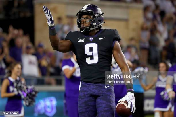 John Diarse of the TCU Horned Frogs celebrates after scoring a touchdown against the Kansas Jayhawks in the first half at Amon G Carter Stadium on...