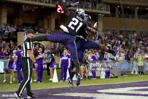 John Diarse of the TCU Horned Frogs celebrates with Kyle Hicks of the TCU Horned Frogs after scoring a touchdown against the Kansas Jayhawks in the...