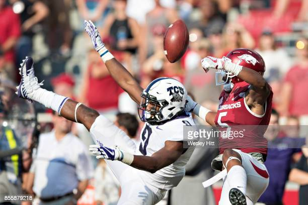 John Diarse of the TCU Horned Frogs has a pass broken up by Henre' Toliver of the Arkansas Razorbacks at Donald W Reynolds Razorback Stadium on...