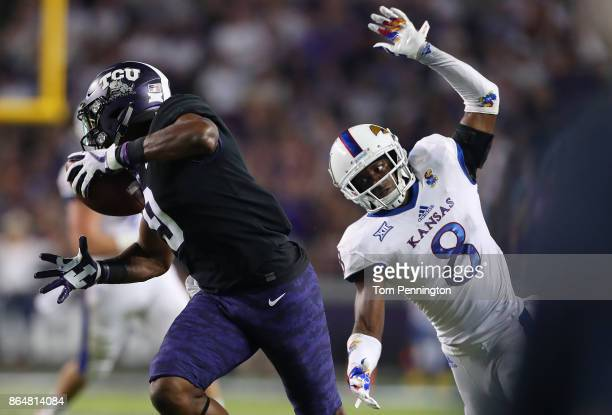 John Diarse of the TCU Horned Frogs pulls in a touchdown pass against Shakial Taylor of the Kansas Jayhawks in the first half at Amon G Carter...
