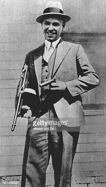 John Dillinger John Dillinger 19031934 Criminal bank robber USA Dillinger posing with a machine gun and handgun June 1934