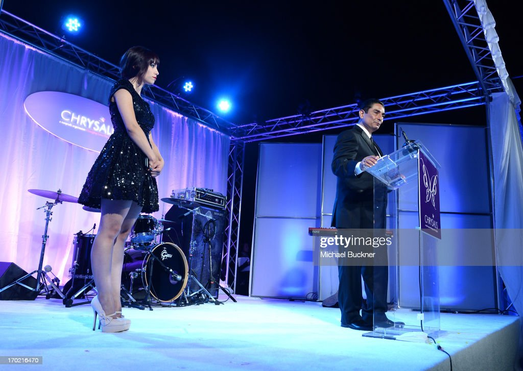 John Dillon Award Recipient Johnny Gutierrez (R) and daughter Christina Gutierrez onstage during the 12th Annual Chrysalis Butterfly Ball on June 8, 2013 in Los Angeles, California.