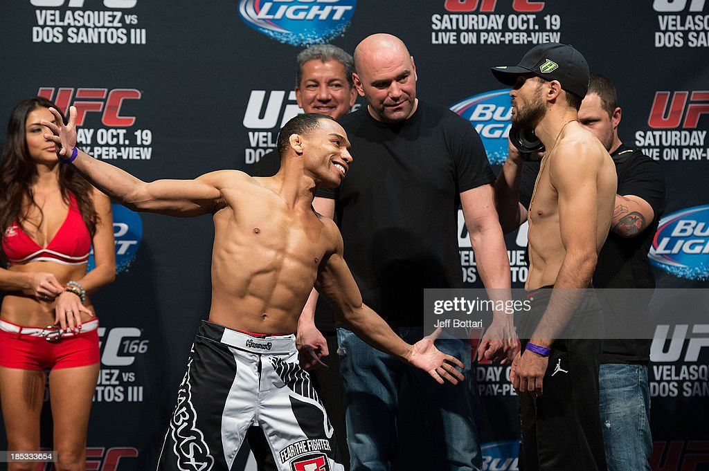 John Dodson and Darrell Montague face off during the UFC 166 weigh-in at the Toyota Center on October 18, 2013 in Houston, Texas.