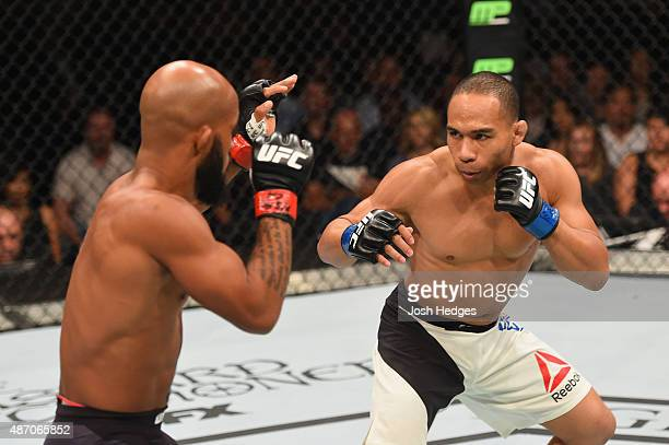 John Dodson and Demetrious Johnson face off in their flyweight championship bout during the UFC 191 event inside MGM Grand Garden Arena on September...