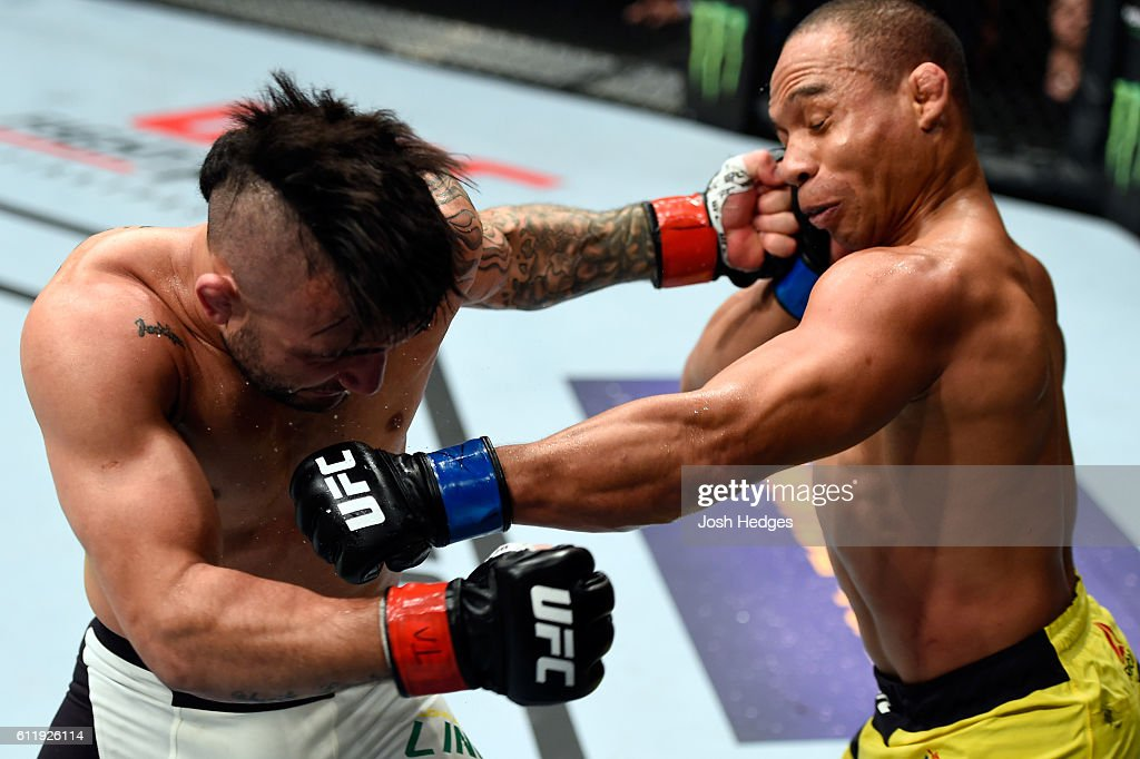 John Dodson and John Lineker of Brazil exchange punches in their bantamweight bout during the UFC Fight Night event at the Moda Center on October 1, 2016 in Portland, Oregon.
