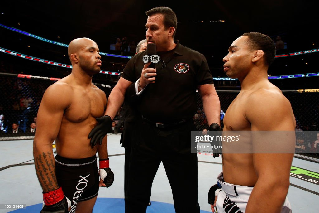 John Dodson (R) face off with Demetrious Johnson (L) during thier Flyweight Championship Bout part of UFC on FOX at United Center on January 26, 2013 in Chicago, Illinois.