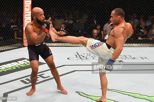 John Dodson kicks Demetrious Johnson in their flyweight championship bout during the UFC 191 event inside MGM Grand Garden Arena on September 5 2015...