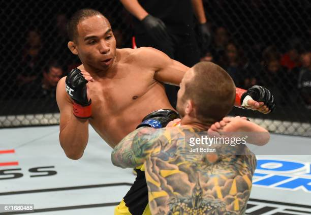 John Dodson kicks Eddie Wineland in their bantamweight bout during the UFC Fight Night event at Bridgestone Arena on April 22 2017 in Nashville...