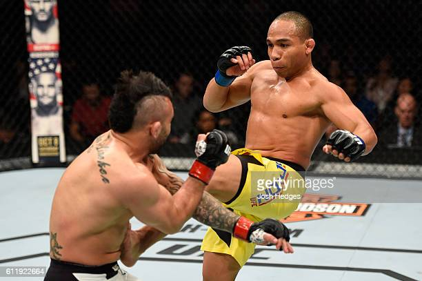 John Dodson kicks John Lineker of Brazil in their bantamweight bout during the UFC Fight Night event at the Moda Center on October 1 2016 in Portland...