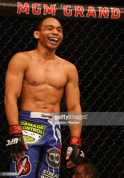 John Dodson laughs in between rounds during the UFC 187 event at the MGM Grand Garden Arena on May 23 2015 in Las Vegas Nevada