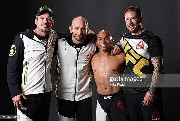 John Dodson poses for a portrait with his team backstage during the UFC Fight Night event at Amalie Arena on April 16 2016 in Tampa Florida