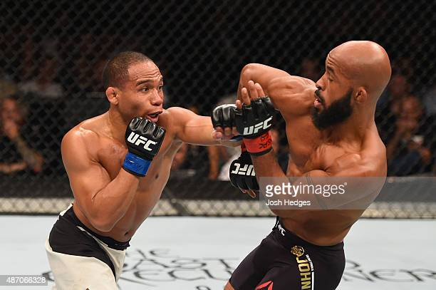 John Dodson punches Demetrious Johnson in their flyweight championship bout during the UFC 191 event inside MGM Grand Garden Arena on September 5...