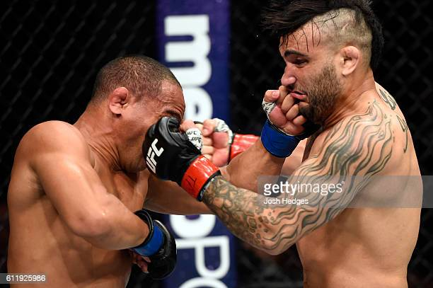 John Dodson punches John Lineker of Brazil in their bantamweight bout during the UFC Fight Night event at the Moda Center on October 1 2016 in...