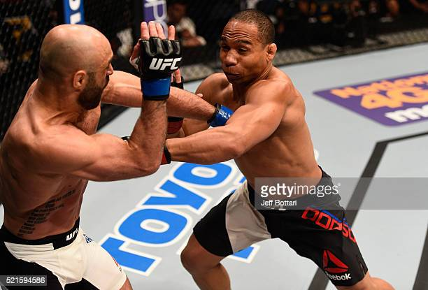 John Dodson punches Manny Gamburyan in their flyweight bout during the UFC Fight Night event at Amalie Arena on April 16 2016 in Tampa Florida