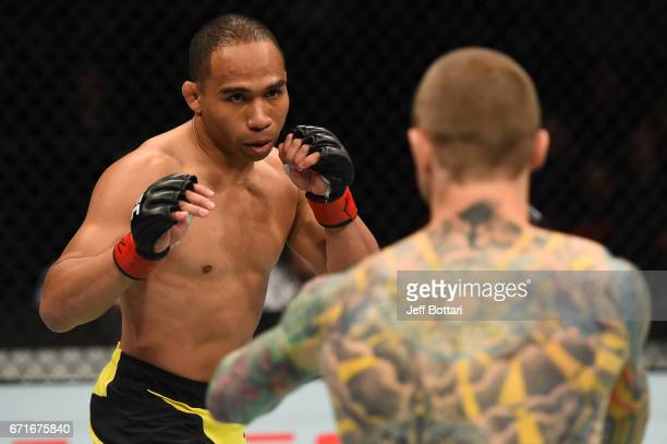 John Dodson squares off with Eddie Wineland in their bantamweight bout during the UFC Fight Night event at Bridgestone Arena on April 22 2017 in...