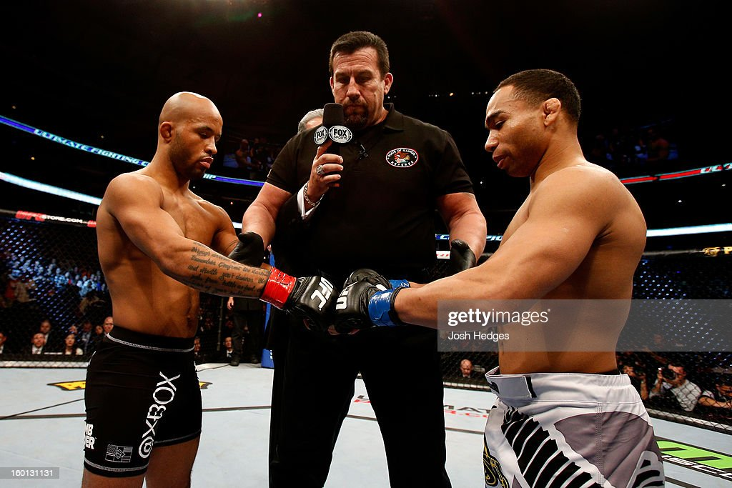 John Dodson (R) taps gloves with Demetrious Johnson (L) during thier Flyweight Championship Bout part of UFC on FOX at United Center on January 26, 2013 in Chicago, Illinois.