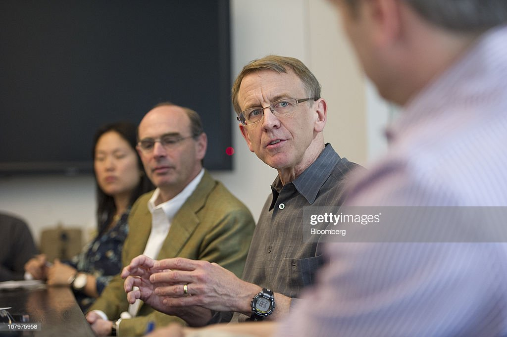John Doerr, a senior partner with Kleiner Perkins Caufield & Byers, second right, speaks as Ted Schlein, a managing partner at Kleiner Perkins Caufield & Byers, center, listens during an interview in San Francisco, California, U.S., on Friday, May 3, 2013. Google Inc. has called on venture capital heavyweight Kleiner Perkins Caufield & Byers to spur creation of software for Google Glass, its wearable mobile-computing devices that resemble spectacles. Photographer: David Paul Morris/Bloomberg via Getty Images