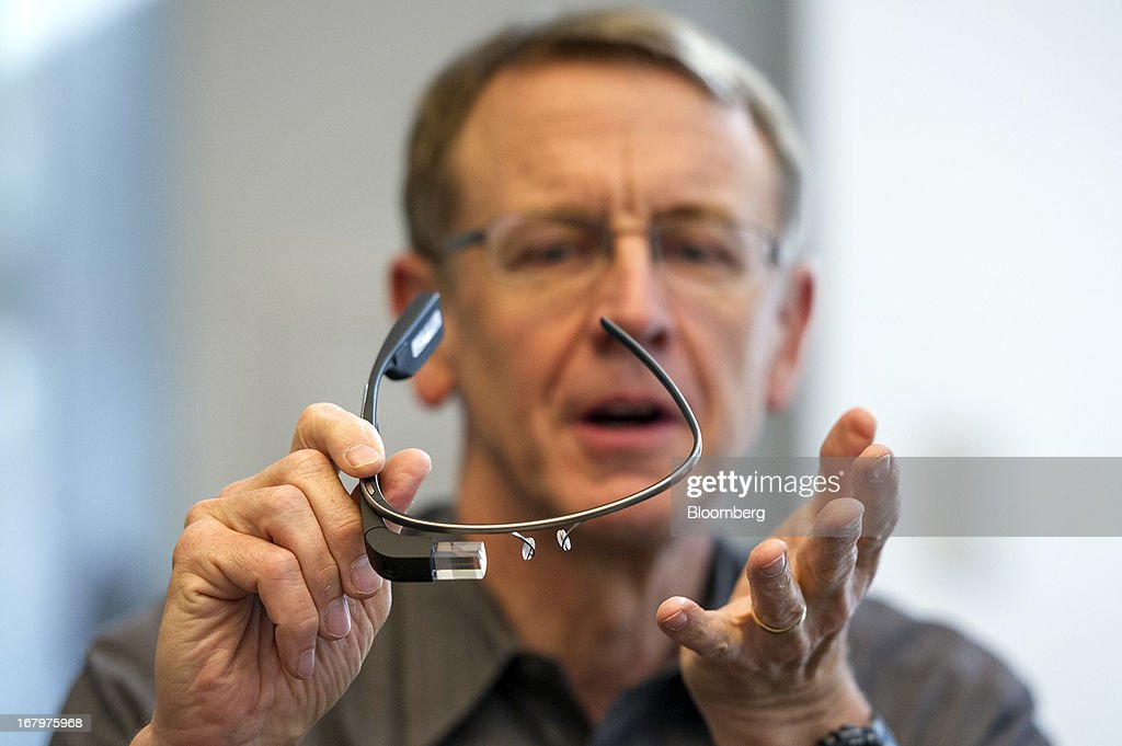 John Doerr, a senior partner with Kleiner Perkins Caufield & Byers, holds a pair of Google Inc. Glass internet glasses as he speaks during an interview in San Francisco, California, U.S., on Friday, May 3, 2013. Google Inc. has called on venture capital heavyweight Kleiner Perkins Caufield & Byers to spur creation of software for Google Glass, its wearable mobile-computing devices that resemble spectacles. Photographer: David Paul Morris/Bloomberg via Getty Images