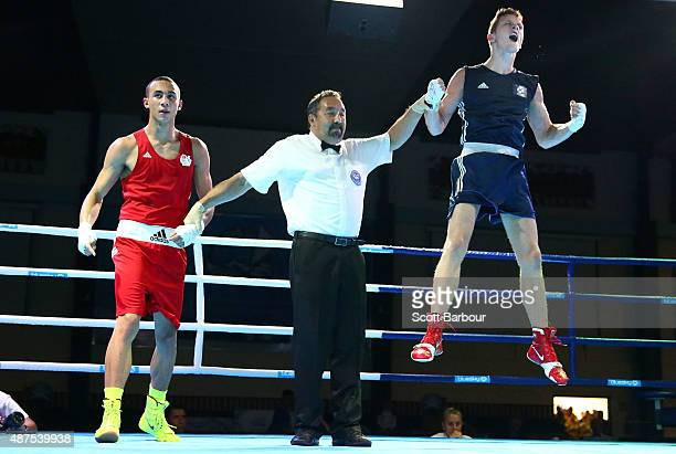 John Doherty of Scotland celebrates as he is announced as the the winner over Benjamin Whittaker of England during the Youth's Middle 75kg Boxing...