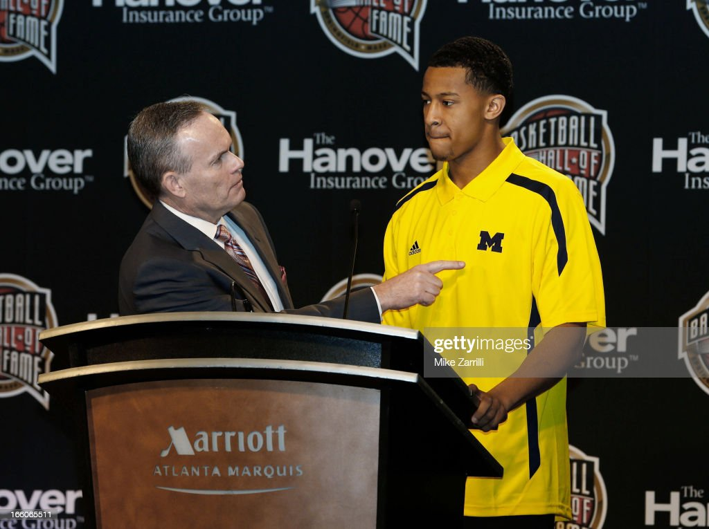 John Doleva (R), President/CEO of the Naismith Basketball Hall of Fame talks to Michigan point guard <a gi-track='captionPersonalityLinkClicked' href=/galleries/search?phrase=Trey+Burke&family=editorial&specificpeople=8770717 ng-click='$event.stopPropagation()'>Trey Burke</a>, winner of the 2013 Bob Cousy Award, at Marriott Marquis on April 8, 2013 in Atlanta, Georgia.