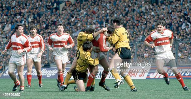 John Dorahy of Hull KIngston Rovers is stopped by Martin Ketteridge B Johnson and Kevin Ward of Castleford during the Rugby League Challenge Cup...