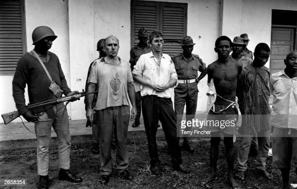 John DowningTractor a company rep and William Blakeley a marine manager after they had been captured and beaten up by Nigerian Federal Troops during...