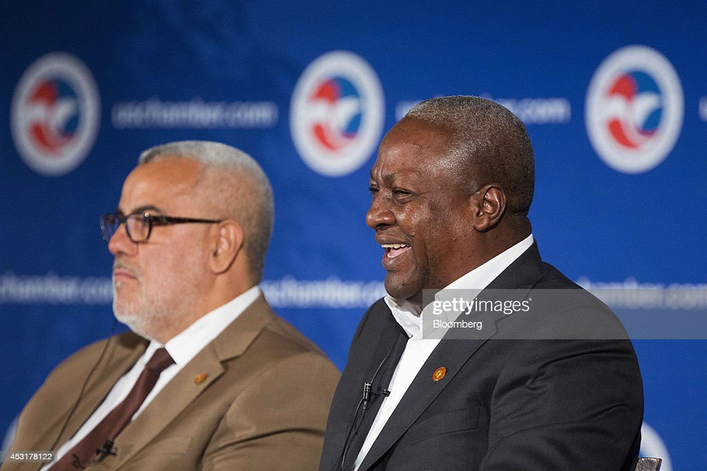 John Dramani Mahama, president of Ghana, right, laughs during a panel discussion with Abdelilah Benkirane, prime minister of Morocco, at the U.S. Chamber of Commerce in Washington, D.C., U.S., on Monday, Aug. 4, 2014. The chamber and Investec Asset Management (IAM) are releasing a joint report today on the ways U.S.-Africa engagement can deepen and improve. Photographer: Drew Angerer/Bloomberg via Getty Images