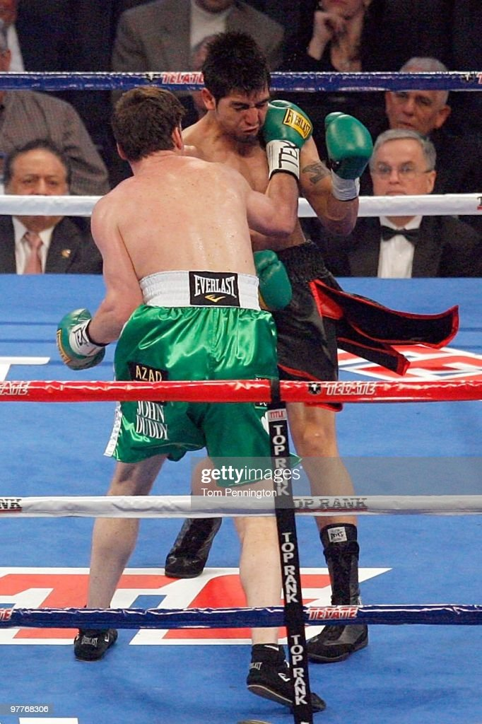 John Duddy of Ireland throws a right to the face of Michael Medina of Mexico during the middleweight fight at Cowboys Stadium on March 13, 2010 in Arlington, Texas. Duddy defeated Medina by split decision.