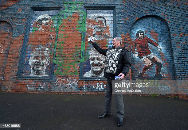 John Dumigan hands out religious tracts against the backdrop of a George Best mural as the Evangelical Protestant Society hold a protest against...