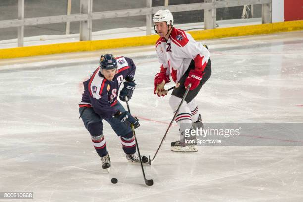 John Dunbar of Team USA and Mike Commodore of Team Canada contest the puck during the Melbourne Game of the Ice Hockey Classic on June 24 2017 held...