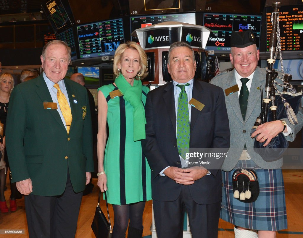 John Dunleavy, Nan Moore Smith, Alfred E. Smith IV, Grand Marshal of the 252nd St. PatrickÕs Day Parade and Joe Brady visit the trading floor of the New York Stock Exchange in honor of St. PatrickÕs Day on March 14, 2013 in New York City.