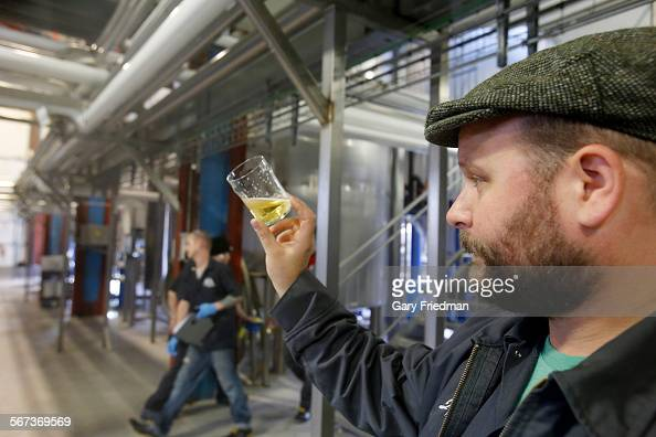 John Dunne a brewer checks a 329 Lager beer for clarity and carbonation at the Golden Road Brewing on December 12 in Glendale Tony Yanow owns Golden...