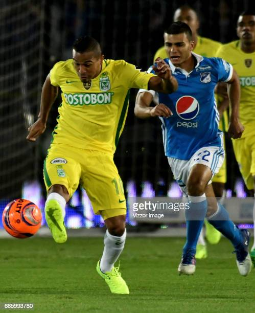 John Duque of Millonarios vies for the ball with Macnelly Torres of Atletico Nacional during the match between Millonarios and Atletico Nacional as...