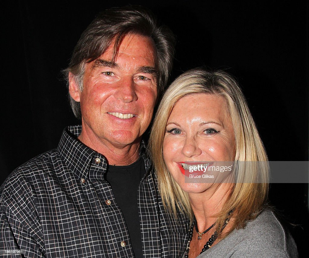 John Easterling and wife <a gi-track='captionPersonalityLinkClicked' href=/galleries/search?phrase=Olivia+Newton+John&family=editorial&specificpeople=206842 ng-click='$event.stopPropagation()'>Olivia Newton John</a> pose backstage at 'A Night with Janis Joplin' at The Lyceum Theater on October 28, 2013 in New York City.