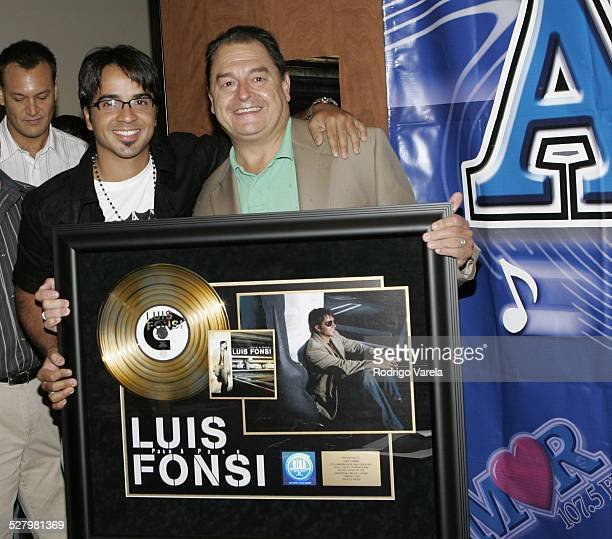 John Echevarria and Luis Fonsi during Universal Music Presents Gold Record to Luis Fonsi at Amor 1057 in Miami Florida United States