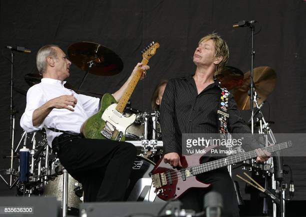 John Edwards and Francis Rossi of Status Quo performing during the 2009 Glastonbury Festival at Worthy Farm in Pilton Somerset