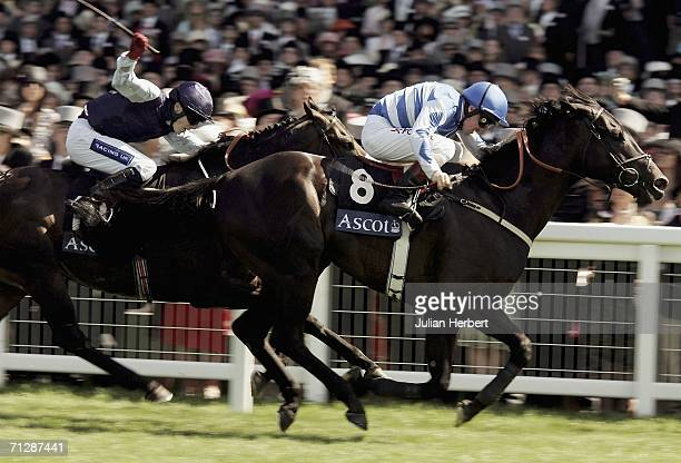 ASCOT ENGLAND JUNE 24 John Egan and Les Arcs lead the Jamie Spencer ridden Balthazaar's Gift home to land The Golden Jubilee Stakes run at Ascot on...