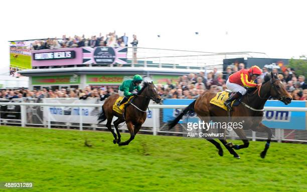 John Egan riding Verse Of Love win The Betfair Price Rush Handicap Stakes at Chester racecourse on May 09 2014 in Chester England