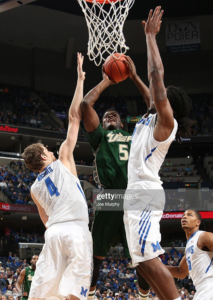 John Egbunu #5 of the USF Bulls shoots against <a gi-track='captionPersonalityLinkClicked' href=/galleries/search?phrase=Austin+Nichols+-+Basketball+Player&family=editorial&specificpeople=15108556 ng-click='$event.stopPropagation()'>Austin Nichols</a> #4 and Shaq Goodwin #2 of the Memphis Tigers on January 26, 2014 at FedExForum in Memphis, Tennessee. Memphis beat South Florida 80-58.