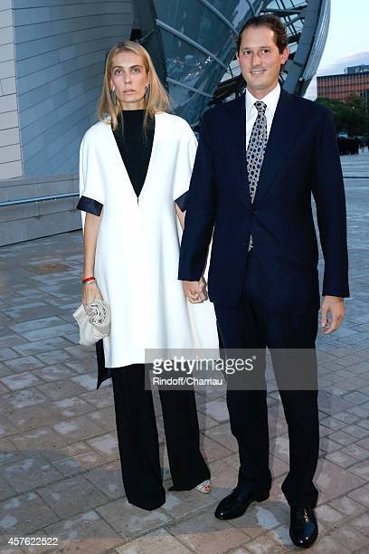 John Elkan and his wife Laviana Elkan attend the Fondation Louis Vuitton Opening at Fondation Louis Vuitton on October 20 2014 in BoulogneBillancourt...